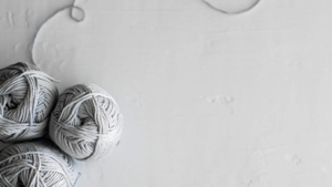 Flat lay of three grey yarn skeins